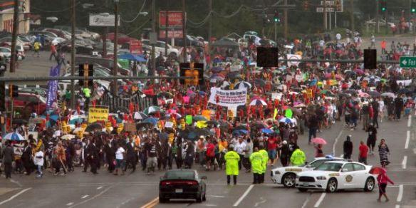 Ferguson-crowd-marches-down-street-830-14