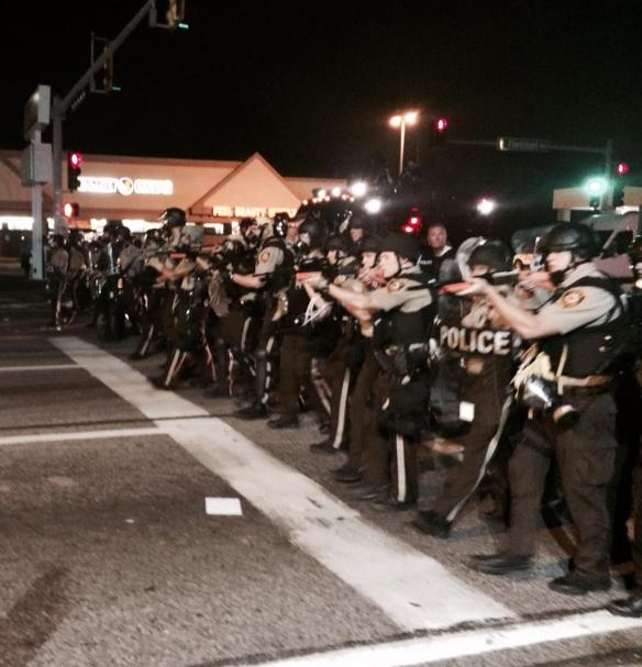 Ferguson riot police point guns
