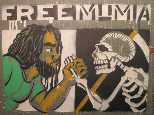 Mumia shakes hands with death-- Seth Tobocman-
